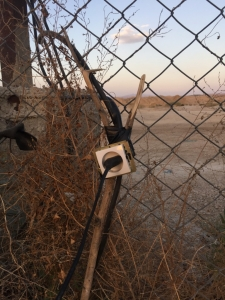 Nice wiring - a household electrical socket attached to a chain-mesh fence - what could possibly go wrong?