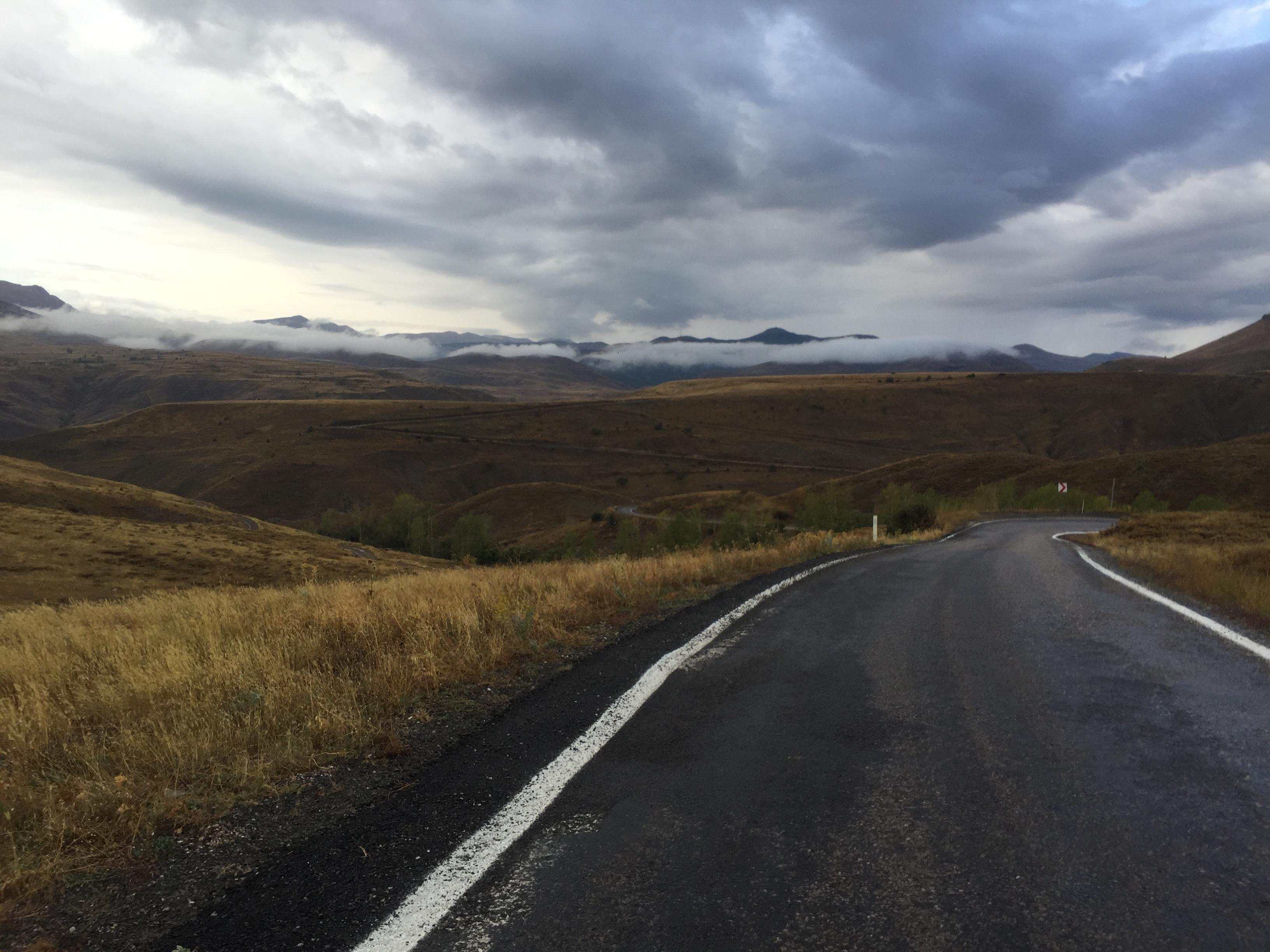 Narrow road, misty morning